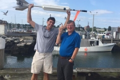 *Bo Hoppin executive director of Hurricane Island Center for Science and Leadership and Graham Hawkes inventor and owner of HAWX Open Ocean show off Sea Rocket in Rockland, ME